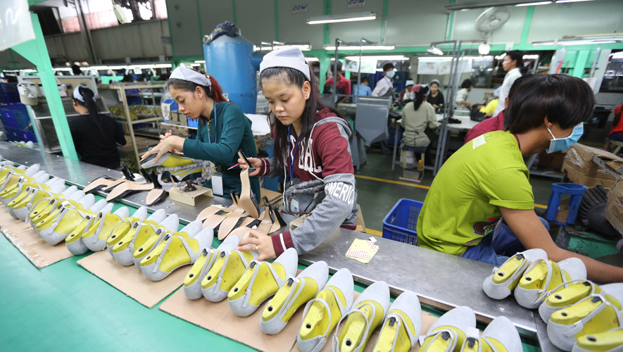 Shoe factory staff working on products for the export market CC/Chor Sokunthea
